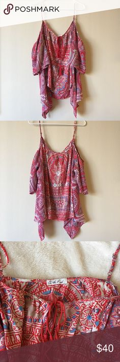 🌹NWT🌹On The Road Cam Cold Shoulder Top **NWT** On The Road Cam Cold Shoulder Top - Small (loose fitting can fit a medium) - Red Paisley - Rayon - Adjustable straps - Gorgeous top with exposed shoulder for a flirty look!  Draps over with wide loose sleeves - Suppose to be loose fitting for that boho look - Beautiful print with a tie in the front - Pair it over shorts or skinny jeans, you'll love this on! 💗 Comment me if you have any questions and send me your bundle for a special discount…