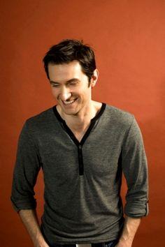 So handsome! I feel like I've hardly ever seen him smile! :(