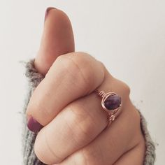 A gorgeous rose gold, wire-wrapped ring with an amethyst stone at the centre. •Amethyst is the birthstone of February• Made with rose gold, tarnish resistant 20 gauge wire, meaning theres no need to worry about fingers turning green, and handmade to order. The size and shape of each