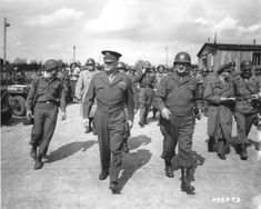 General Dwight D. Eisenhower and General Troy Middleton, commanding general of the XVIII Corps, Third US Army, tour the newly liberated Ohrdruf concentration camp. Ohrdruf, Germany, April 12, 1945. Liberated by American troops, including 174th Field Artillery Battalion.