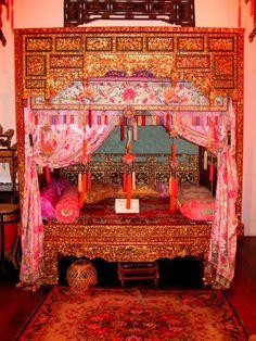 A typical Peranakan bed.