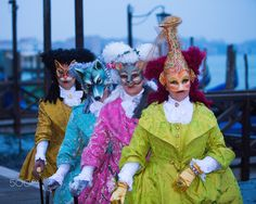Venice-Carnival - #124 - If you want a multi-model ensemble with a theme, then this group is for you.  We've got a fish, a mouse, a wolf, and a cat costume.  They are posing early in the morning along the waterfront at San Marco Square with San Giorgio Island in the background.  Carnival, Venice, Italy.