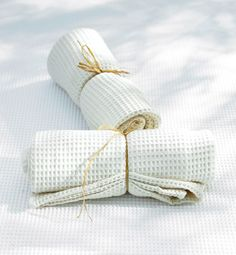 Use an old tablecloth as... a quick stash of napkins. Cut a partly stained tablecloth into rectangles to create a set of napkins. You could also buy an extra tablecloth and cut it into napkins to match the first tablecloth you purchased.