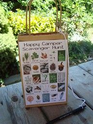 Camping bingo game for the kids.  Lots of other great ideas on this site.  I would have the boys work in teams and use a digital camera to document their finds to follow the principles of Leave No Trace. mh