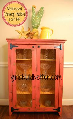Distressed Dining Hutch by girlsbuildbetter.blogspot.com  I kinda like this but with a glass like windows not fence looking ones. And painted/ stained black