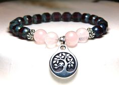 Subtle Rose Quartz and Amethyst make this Tree of Life Bracelet so pretty. It made with 8mm Amethyst Czech Beads and 8mm Rose Quartz with a Tree of Life charm. Rose Quartz Properties: Known as a stone
