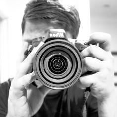nikon photographer with camera in mirror