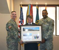https://flic.kr/p/23QXY5c | LTC Swanson | WSMR Brig. Gen. Eric Sanchez, left, and WSMR Command Sgt. Maj. William Wofford, right, presented a frame to McAfee Commander Lt. Col. Kirsten Swanson, March 15. Swanson was the guest speaker at the 2018 Women's History Luncheon at WSMR.