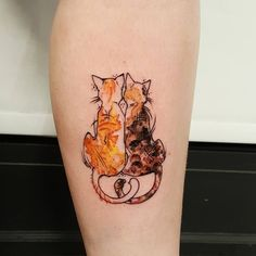 Tattoo of orange & tortoise shell cats.