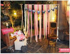 Fun photo booth at a Minnie Mouse birthday party! See more party ideas at CatchMyParty.com!