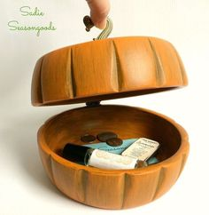 She took two wooden salad bowls from the thrift store and a few other items she had on hand to create this DIY pumpkin box.