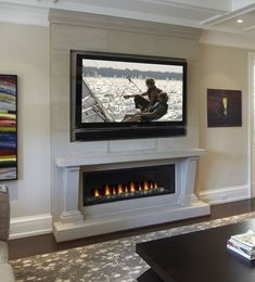Efficient living room decoration giving exotic combination of gas burning fireplace and TV wall Image 22 - SHAIROOM. Tv Above Fireplace, Linear Fireplace, Small Fireplace, Home Fireplace, Faux Fireplace, Fireplace Remodel, Living Room With Fireplace, Fireplace Surrounds, Fireplace Design
