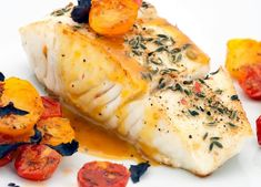 Discover my quick and easy dinner recipe for pan roasted sea bass with tomato, garlic and capers.