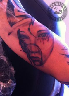 inside-arm tattoo. eyes and lips beautiful