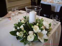 RG138 oasis garland or wreath arrangement with a hurricane lamp