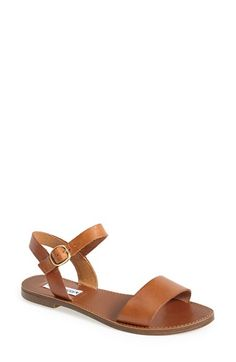 Free shipping and returns on Steve Madden 'Donddi' Ankle Strap Sandal (Women) at Nordstrom.com. What could be more chic for warm weather than a leather ankle-strap sandal with a sleek, streamlined design?<br><br>Stay a step ahead in Steve Madden's easy-to-wear silhouettes. Inspired by rock 'n' roll and fused with a jolt of urban edge, Madden creates products that are innovative, sometimes wild and always of-the-moment.