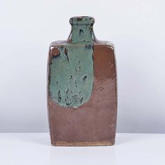Bottle Vase Stoneware, persimmon glaze with running mottled celadon