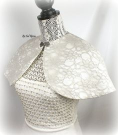 ***Ready To Ship. This cape is a SMALL size   *** This bolero can be made in any color combination to complement your gown. This gorgeous bridal cape / bolero has been crafted in a pretty gray/silver lace fabric over ivory satin. The cape has been fully lined in ivory satin- it is so luxurious! A pretty silver vintage-style clasp finishes the look. This bridal capelet, like the rest of my creations, has been crafted with extreme attention to detail and using only quality materials. ...