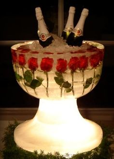 Beautiful Champagne presentation for a Wedding! Extra large punch bowl with roses frozen inside. Form the cavity for Champagne by securing another container inside the bowl before freezing to form the well for Champagne. Add a battery powered light under the base!