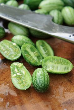 """British article on Cucamelon, a Exotic Mexican plant/fruit also known as """"Mouse Melon"""": This odd-looking fruit looks like a tiny watermelon but tastes like a cucumber. Fruit And Veg, Fruits And Vegetables, Growing Vegetables, Sutton Seeds, Cute Fruit, Growing Grapes, Growing Tomatoes, Edible Garden, Fruit Garden"""