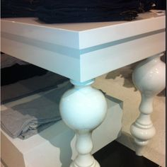 Would love a table like this, glossy white, vintage inspired, with a modern twist.