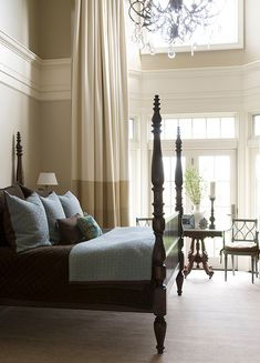 Beautiful Master Bedroom with tall cream bordered drapery panels