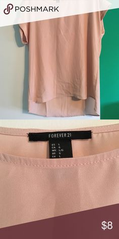 Cream high low shirt Never worn. Might be tight on a large if chesty. Forever 21 Tops