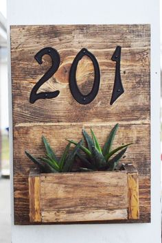 Dress up your porch with this easy rustic hanging planter box sign featuring your street numbers and succulents! Beginner project making a BIG impact!!