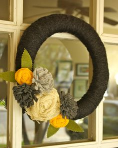 Spring wreath - yarn wrapped with felt and burlap flowers