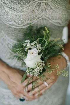 We highly recommend mothers carrying tussle mussies, small handheld bouquets. This allows them to set them down when talking or mingling, and not tying up their hands.   Photo by Jonas Seaman Photography