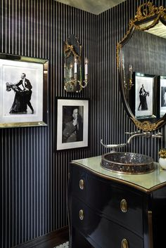 a little black goes a long way in a powder room. Love the black and white classy prints and vanity unit in glossy black. I like the thin stripe, sort of dark pin stripe. The gold really makes this small powder room a jewel! Gold Bathroom, Bathroom Interior, Bathroom Mirrors, Bathroom Ideas, White Bathrooms, Luxury Bathrooms, Dream Bathrooms, Small Bathroom, Modern Bathrooms