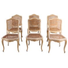 Set of Six 19th Century Ivory Painted and Parcel-Gilt Chairs | From a unique collection of antique and modern dining room chairs at https://www.1stdibs.com/furniture/seating/dining-room-chairs/