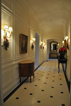 well appointed hallway with wall panels, brass sconces, inlaid cabinet and consul table; Home Room Design, Home Interior Design, Interior And Exterior, House Design, Flur Design, Deco Retro, Hallway Designs, Enchanted Home, Hallway Lighting