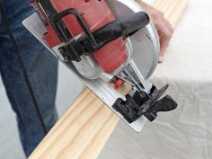 "Use a circular saw to cut out the back of the table frame. Cut 1"" x 4"" pine boards to frame your plywood. For this frame, we cut two board lengths at 48"" long and two board lengths at 22 1/2"" long."