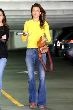Victoria's Secret angel Alessandra Ambrosio continues to hit the '70s trend in these J Brand jeans paired with an Armani Exchange sweater and Gucci satchel for a vintage touch.