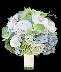 This is very similar to what we're currently considering for my bouquet.  I love the mix of ivory/white, blues, and greens.  It pulls together the majority of our wedding colors, and incorporates orchids (which I love!).