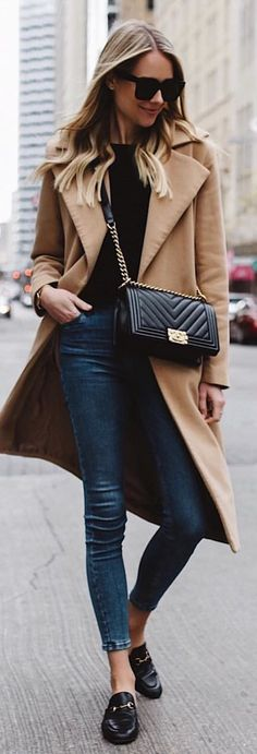 #winter #outfits brown trench coat, black top, and blue jeans