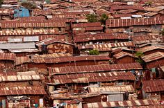 The Slum in Kibera, Africa    Kenya's slum population is growing by almost 6 per cent each year. Kibera is the biggest slum in Africa and one of the biggest in the world.