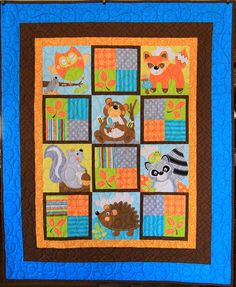 Baby Animal Quilt with Bear, Fox, Owl, Raccoon, Hedgehog and Squirrel blocks with orange, brown and blue fabrics by MooseBearyQuilting on Etsy