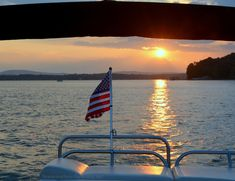 Sunset and American flag on boat Lake Norman | homeiswheretheboatis.net