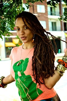 shes a cutie....ohh yea and i love her locs :-)