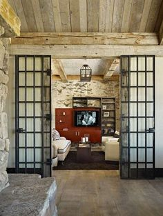 Make your TV room stand out by adding doors as a frame. #interiordesign #design #homedecor