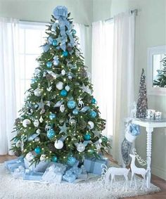 But if you truly want to stand out, we'd suggest you go for a blue Christmas tree this year. we've gathered a list of blue Christmas tree decoration ideas. Blue Christmas, Turquoise Christmas, Silver Christmas Decorations, Coastal Christmas, Modern Christmas, Christmas Christmas, Frozen Christmas Tree, Christmas Photos, Elegant Christmas