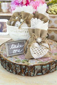Give your guests a pretty send-off with keepsake worthy favor bags made from unadorned burlap pouches. We created an appliqué for our look. And we paired it with a jewel from a bridal hairpin. All the elements were glued into place. The heart was cut out of lace ribbon and edged with pearl trim.