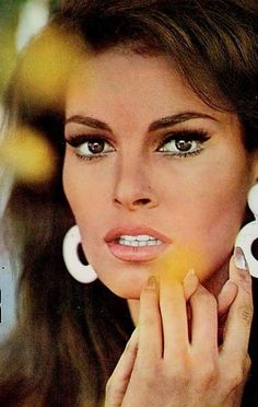 ...Raquel Welch.  She is still just as gorgeous today as she was back then.  Can you believe she is 73?  I don't know if it's plastic surgery or if she has some awesome genes but can I have some of that serum please!!! We really love this!