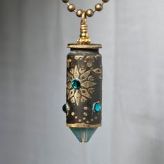 Snowflake etched bullet casing pendant by Dazzlez on Etsy