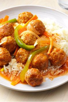 Frozen meatballs and a jar of sweet-and-sour sauce make this microwave meal a last-minute lifesaver when racing against the clock. The flavorful sauce is dressed up with a hint of garlic and nicely coats the colorful mixture of meatballs, carrots, green pepper and onion. | Dressed-Up Meatballs Recipe from Taste of Home