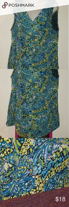 Kim Rogers Ruffle Tank Very pretty multicolored sleeveless blouse. Buttons down the front. Ruffles around front neckline and front of shirt. Fully lined. Blue green yellow and black. 100% polyester. Size 1x. Fits true to size. Bust 22.5 inches flat. Length 29 inches. Kim Rogers Tops Tank Tops