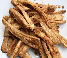 Nut Butter Crusted Parsnip Fries..These Fries Will Change Your Life...  3 med parsnips, 3T nut butter (I used 2T chunky peanut + 1T almond butter)*  1T extra virgin olive oil, 1/4tsp kosher salt  ::Preheat oven to 400F. line a baking sheet with parchment paper. Peel/ cut parsnips strips. mix together nut butters, olive oil, salt. toss in bowl with your hands until fully coated. Line on baking pan and cook at 400F for 30-50 min. They were wonderful!