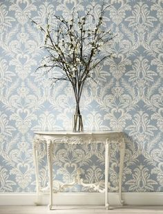 Delicate damask wallpaper corridor opposite dining area